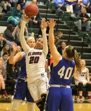 Zaria DeMember-Shazer of Elmira goes up for a shot as Tess Cites (40) and Jenna Granger, back, of Horseheads defend during a Section 4 Class AA girls basketball semifinal Feb. 26, 2019 at Elmira High School.