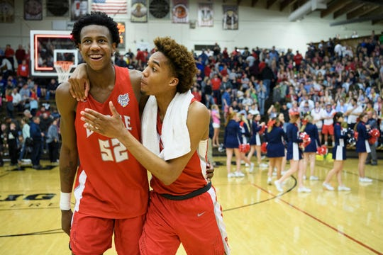 Bosse's Kiyron Powell (52) and Bosse's George Madison III (11) celebrate their 66-62 win over the Heritage Hill Patriots in a first round IHSAA Class 3A sectional match as they walk off the court at Boonville High School in Boonville, Ind., Tuesday, Feb. 26, 2019. The Bulldogs will advance to Friday's 6 p.m. semifinal match-up against Memorial.
