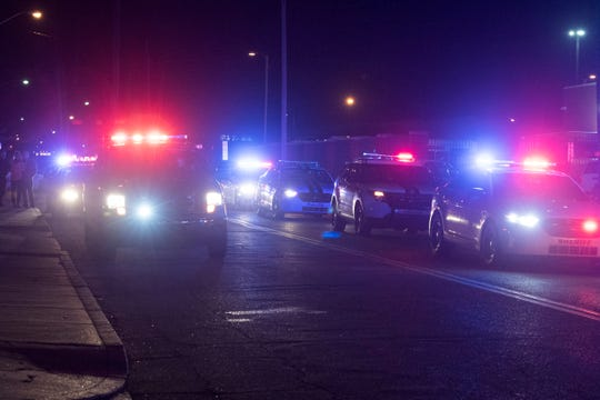A police caravan on the corner of East Sycamore Street and Morton Avenue accompany the body of an Evansville firefighter Robert Doerr to the Vanderburgh County Coroner's Office Tuesday night, Feb. 26, 2019. Doerr was shot and killed outside his home and police are investigating.