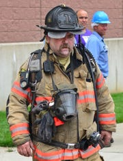 Robert Doerr, a firefighter with the Evansville Fire Department, takes a break from fighting a fire at Berry Plastics on July 3, 2015. Doerr was shot to death by an unknown assailant outside his home Tuesday night.