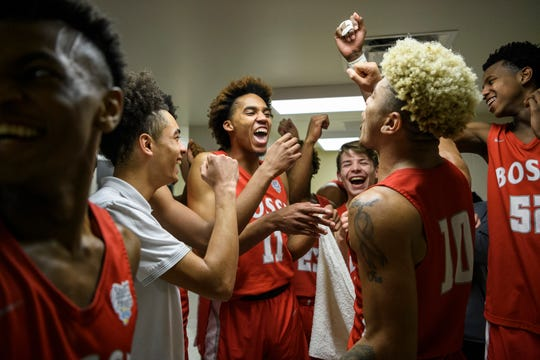 The Bosse Bulldogs celebrate their 66-62 victory over the Heritage Hill Patriots in a first round IHSAA Class 3A sectional matchup at Boonville High School in Boonville, Ind., Tuesday, Feb. 26, 2019. The Bulldogs will advance to Friday's 6 p.m. semifinal match-up against Memorial.