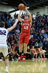 Bosse's Kolten Sanford (45) takes a jump shot over Heritage Hills' Blake Sisley (52) during the IHSAA Class 3A first-round sectional game at Boonville High School in Boonville, Ind., Tuesday, Feb. 26, 2019. The Bulldogs beat Heritage Hills, 66-62, to advance to Friday's 6 p.m. semifinal match-up against Memorial.