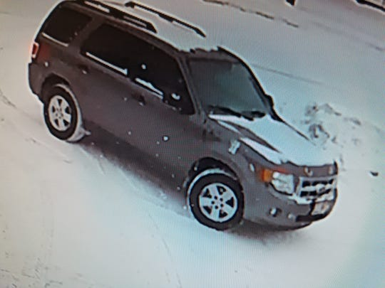 Mohamed G. Elmhdati, wanted for attempted first degree intentional homicide and armed robbery, was last seen in this grey Ford Escape with a bug shield and eye-like designs.