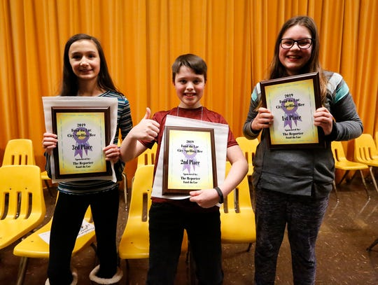 Winners of the 43rd annual Fond du Lac city spelling bee received plaques Tuesday, February 26, 2019, at the event at Theisen Middle School. From left are third-place winner Lacey Keifenheim of Faith Lutheran, second-place winner Ben Tschetter and first-place winner Sophia Utecht, both of Roberts Elementary. A total of 38 students from 19 area schools competed in the event.