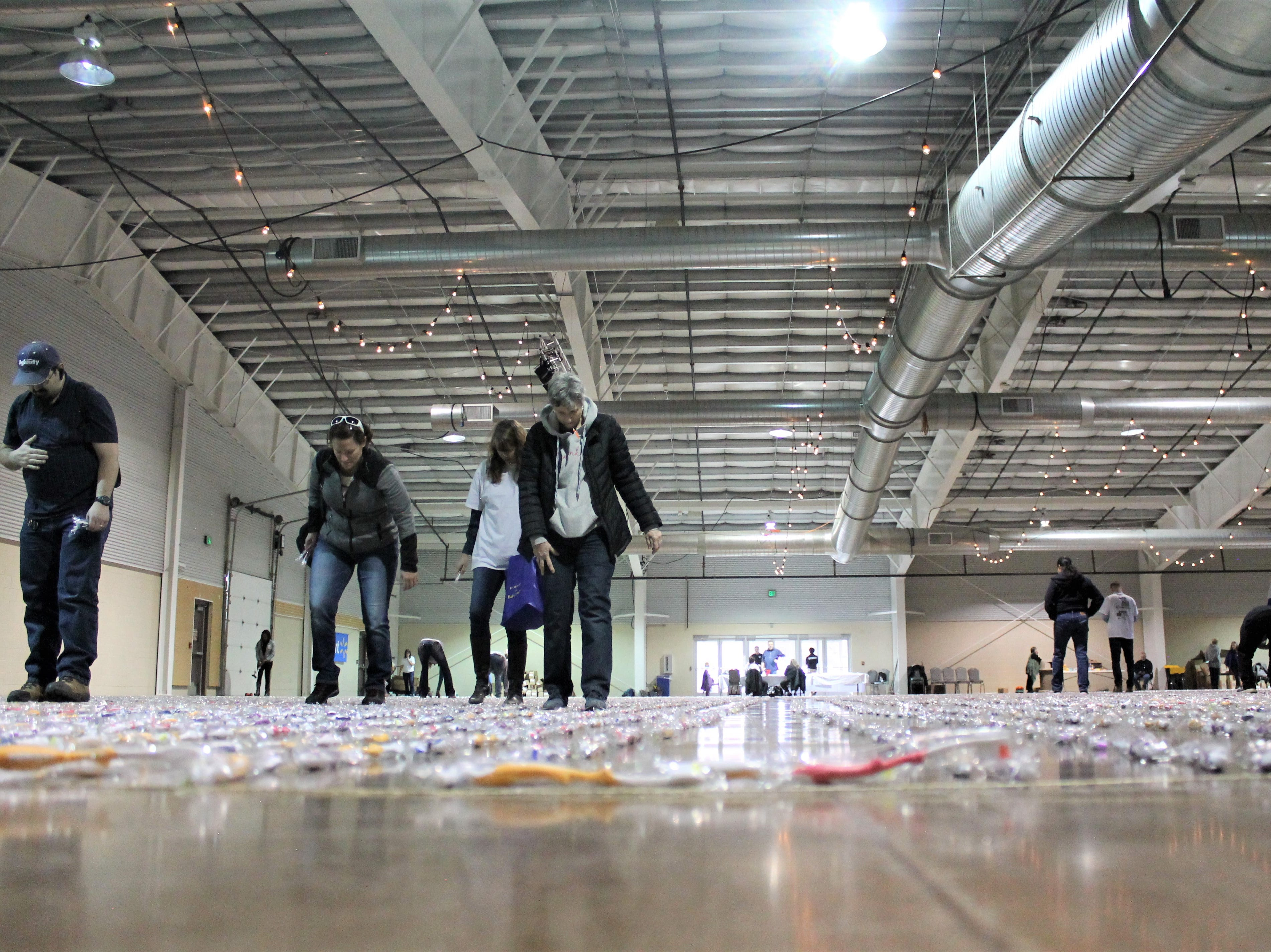 More than 60 volunteers came together Feb. 26, 2019 to line up 41,769 toothbrushes. They succeeded in breaking the Guinness World Record for the most toothbrushes in a continuous line. The toothbrushes will be donated to organizations across Colorado.