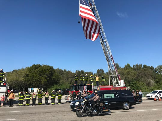A funeral procession for Florida Highway Patrol Master Sgt. Daniel Hinton, who died Feb. 19 of a heart attack during a training exercise, wound its way through Fort Myers and south Lee County Wednesday.