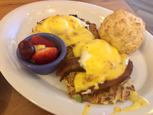 Skillets' Sunrise Benedict starts with a potato-pancake base topped with thick-cut bacon, poached eggs and a sun-dried tomato Hollandaise.