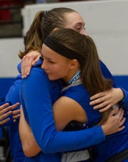 Canterbury's Hannah Galbreath (20), left, and Ashlyn Powers (2) hug each other after their loss to Somerset Prep in the FHSAA Girls 3-A Championship game at The RP Funding Center in Lakeland Tuesday night. Somerset Prep won by a score of 57-33. February 26, 2019. (SPECIAL TO THE NEWS PRESS/MICHAEL WILSON)