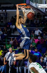 Darron Humphrey scores a critical jam in overtime as the Lightning went on to defeat Fort Myers 65-60 in a Class 7A regional semifinal at Suncoast Credit Union Arena on Tuesday, February 26, 2019.