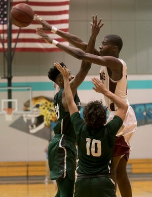 Tyrone Baker of Riverdale makes a pass over Joshua Young of Lakewood Ranch on Tuesday, Feb. 26, 2019, at East Lee County High School in Lehigh Acres.