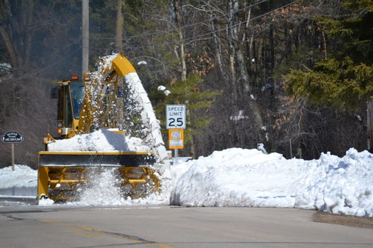 The city of Oconto's front-end loader with a large snow removal head attached clears snow a few days after mid-April 2018 storm in northeast Wisconsin. On Tuesday afternoon (Feb. 26, 2019), the equipment was being driven back to the Street Department when it struck and killed a pedestrian on Pecor Street behind the city Municipal Building.