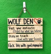 One of several signs at a Wolf Den gathering offers encouragement to the Pups.