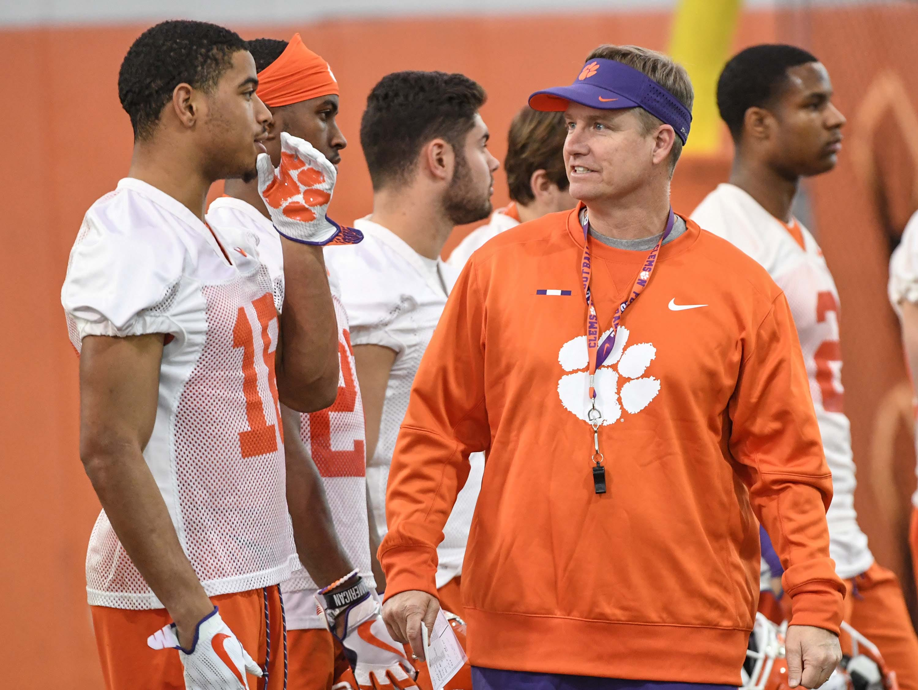 Clemson defensive back Joseph Charleston (18) talks with safeties coach Mickey Conn, right, during the first practice at the Clemson Indoor Practice Facility in Clemson Wednesday, February 27, 2019.