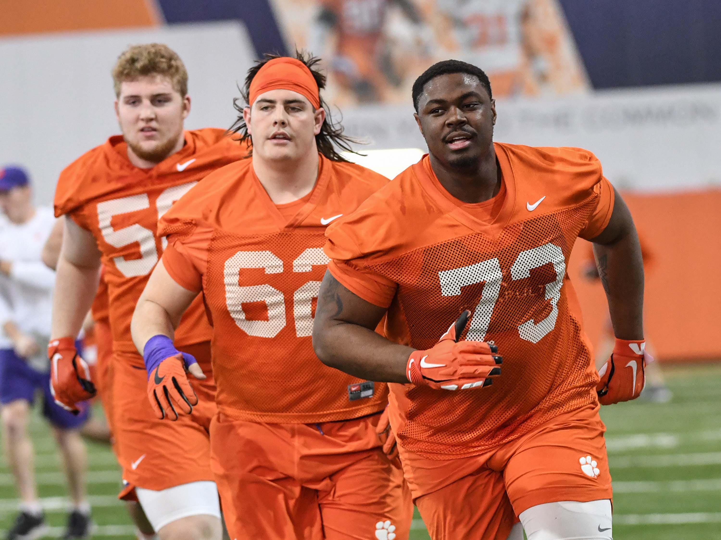 Clemson offensive lineman Will Putnam (56), Clemson offensive lineman Cade Stewart (62), and  offensive lineman Tremayne Anchrum (73) runs during the first practice at the Clemson Indoor Practice Facility in Clemson Wednesday, February 27, 2019.