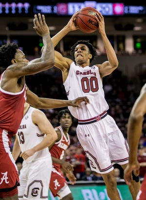 South Carolina guard A.J. Lawson (00) shoots over Alabama guard Tevin Mack (34) in the first half Tuesday night at Colonial Life Arena. Lawson later left the game with an ankle injury.