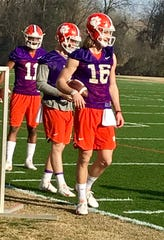 Clemson quarterback trio: Trevor Lawrence (16), Chase Brice (7) and freshman Taisun Phommachanh (11) prep for drills Wednesday, Feb. 27, 2019, at the Tigers' opening practice of spring.