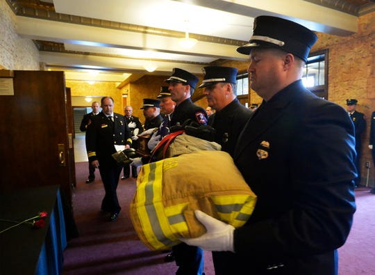 Pallbearers prepare for the procession into the Mansfield Theater during the memorial service for Great Falls firefighter Jason Baker, Tuesday.