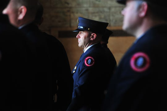 The Monta State Firemen's Association Honor Guard waits for the motorcade ahead of Tuesday's memorial service for Great Falls firefighter Jason Baker at the Mansfield Theater.