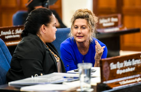 Sen. Kelly Marsh (Taitano), right, chats with Speaker Tina Muña Barnes during a break in session at the Guam Legislature on Tuesday, Feb. 26, 2019.