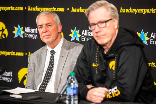 Iowa athletic director Gary Barta, left, and Fran McCaffery listen to a question during a press conference on Wednesday, Feb. 27, 2019, at Carver-Hawkeye Arena in Iowa City, Iowa.