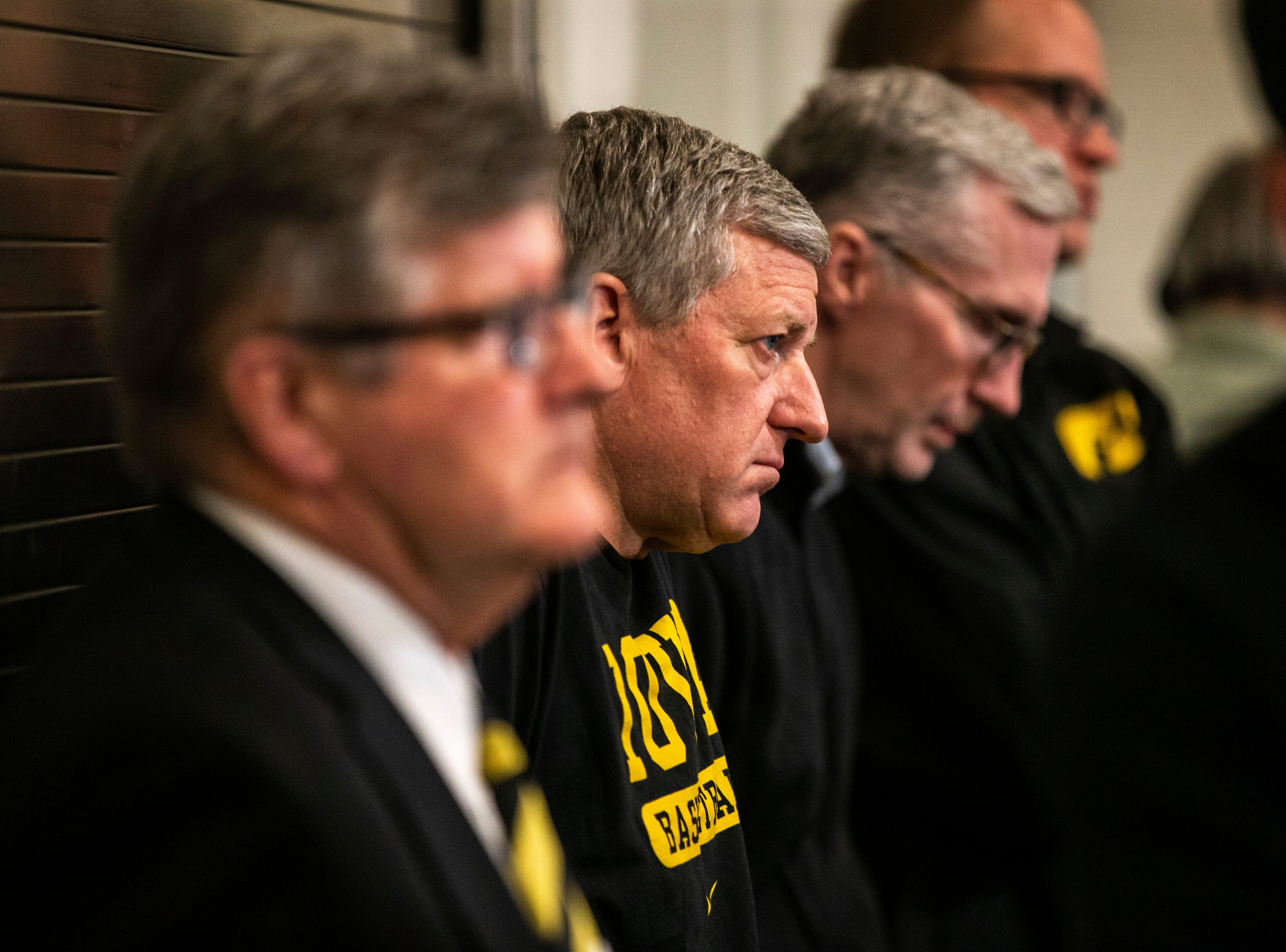 Iowa play-by-play commentator Gary Dolphin and Iowa assistant Kirk Speraw, second from left, listen during a press conference on Wednesday, Feb. 27, 2019, at Carver-Hawkeye Arena in Iowa City, Iowa.