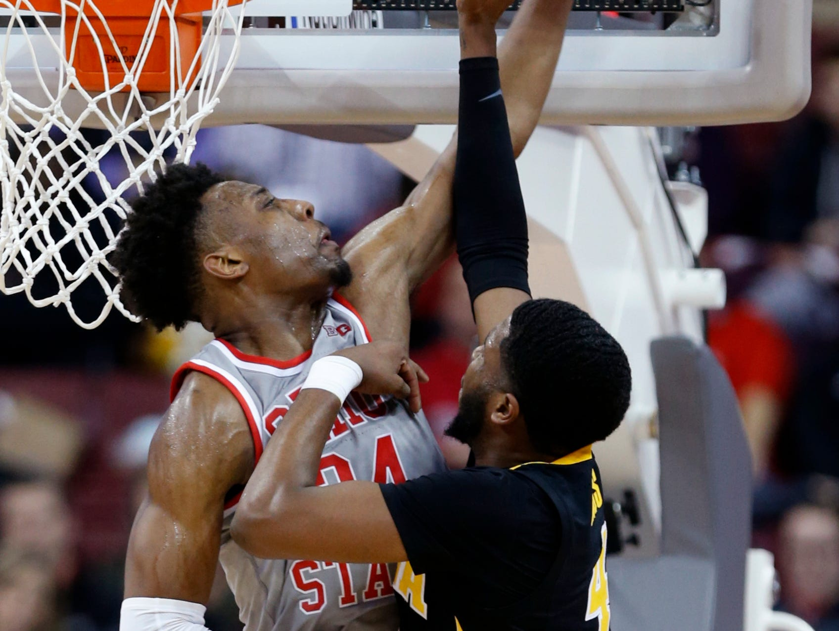 Ohio State forward Andre Wesson, left, blocks a shot by Iowa guard Isaiah Moss during the second half of an NCAA college basketball game in Columbus, Ohio, Tuesday, Feb. 26, 2019. Ohio State won 90-70.