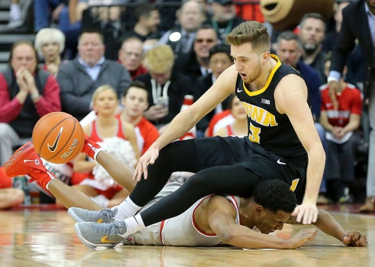 Ohio State 's C.J. Jackson battles for the ball with Iowa's Jordan Bohannon (3) during their game Tuesday, Feb. 26, 2019, in Columbus, Ohio.