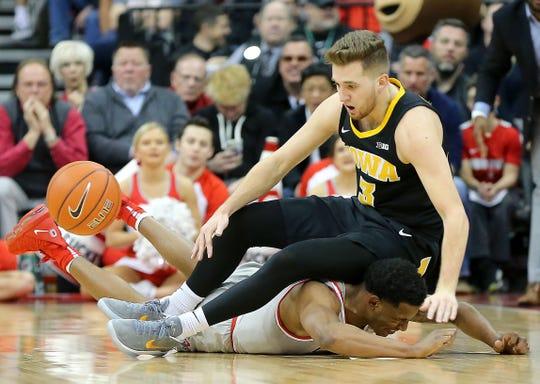 Ohio State 's C.J. Jackson battles for the ball with Iowa's Jordan Bohannon (3) during their game Tuesday, Feb. 26, 2019, in Columbus, Ohio.