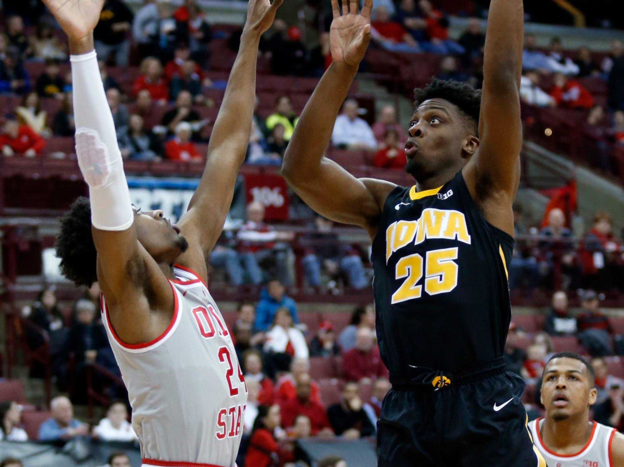 Iowa forward Tyler Cook, right, goes up for a shot against Ohio State forward Andre Wesson during the first half of an NCAA college basketball game in Columbus, Ohio, Tuesday, Feb. 26, 2019.