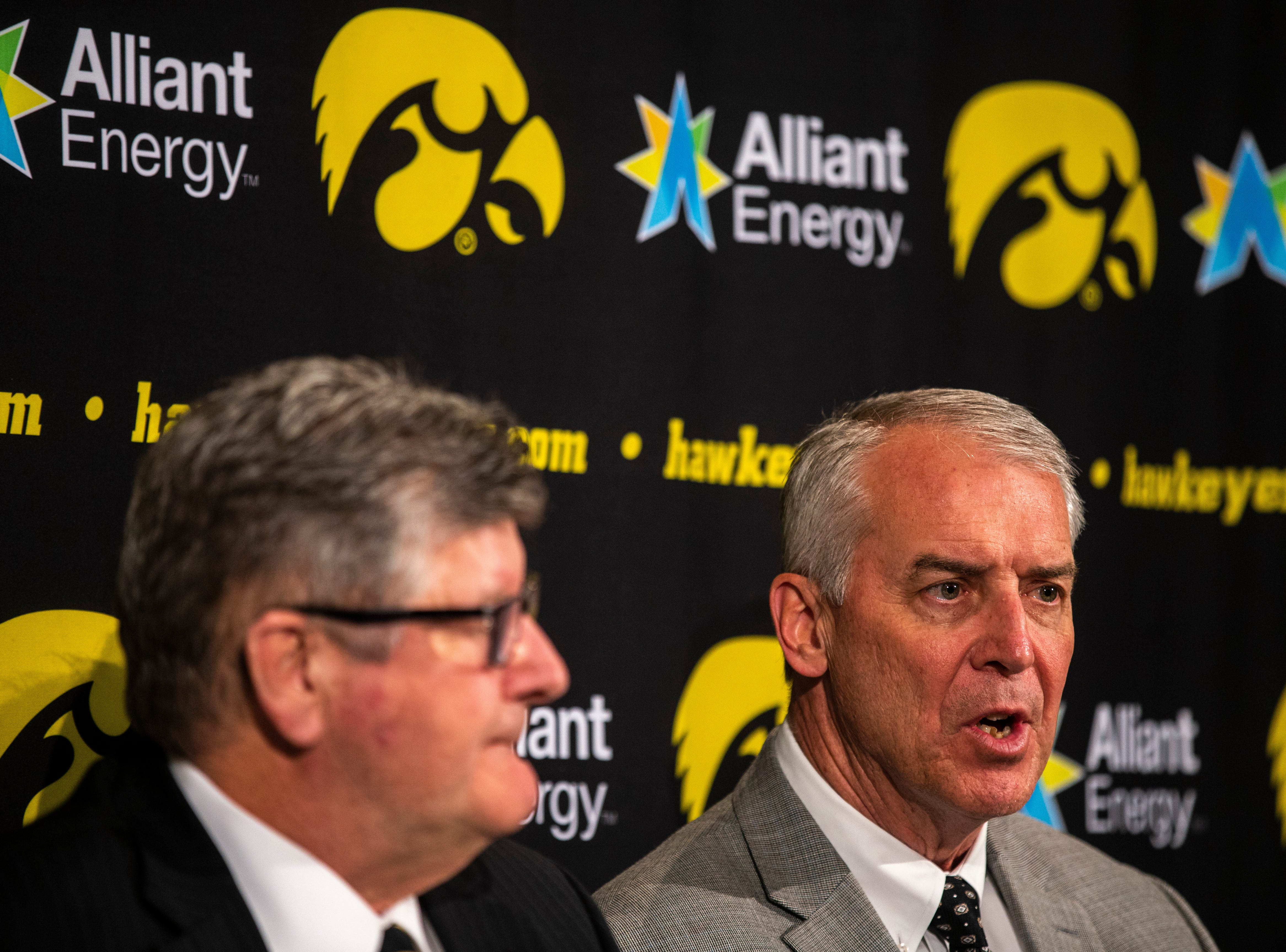 Iowa play-by-play commentator Gary Dolphin, left, listens while Iowa athletic director Gary Barta speaks during a press conference on Wednesday, Feb. 27, 2019, at Carver-Hawkeye Arena in Iowa City, Iowa.