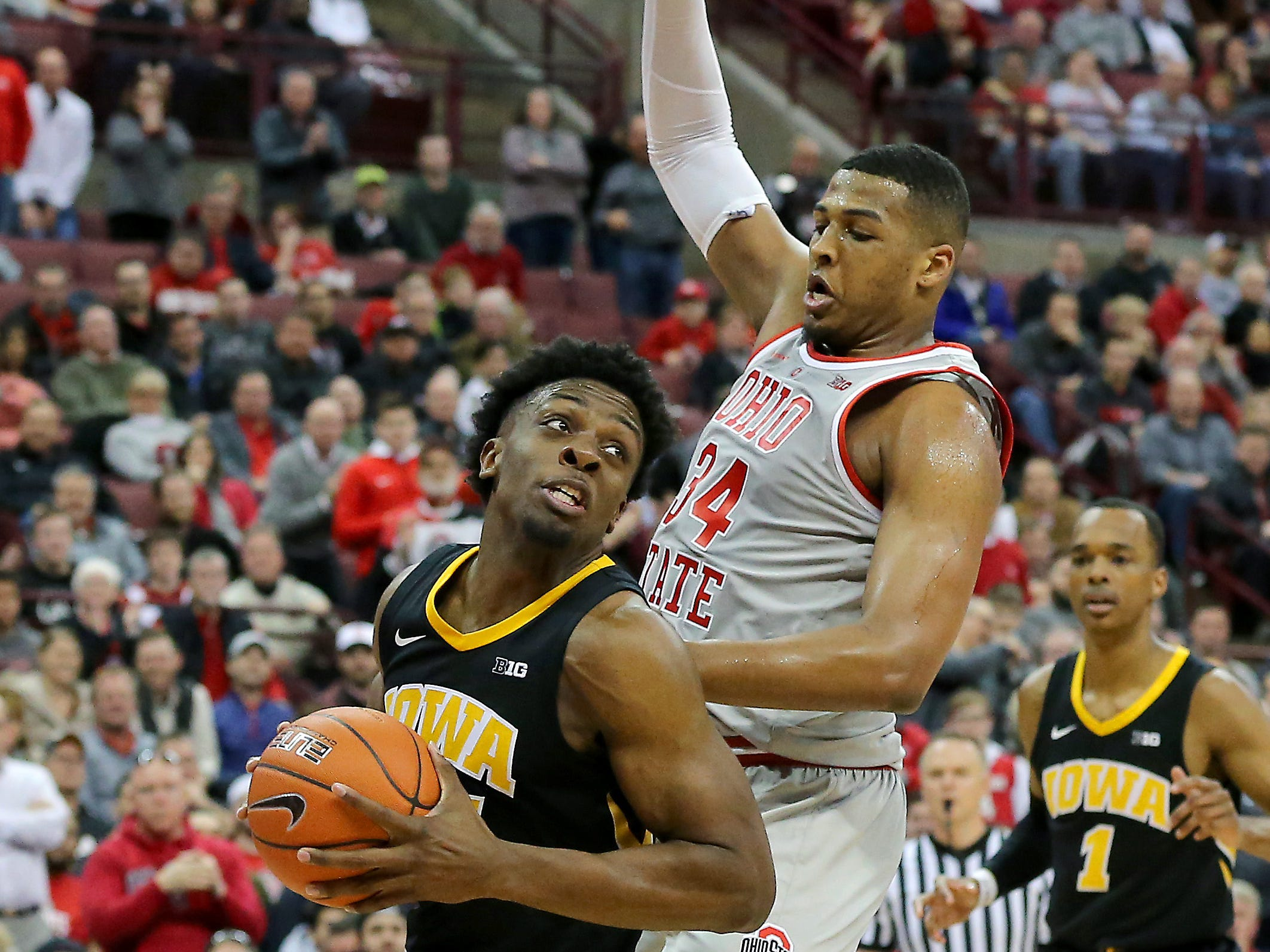 Feb 26, 2019; Columbus, OH, USA; Iowa Hawkeyes forward Tyler Cook (25) past Ohio State Buckeyes forward Kaleb Wesson (34) during the second half at Value City Arena.