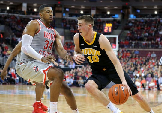 Joe Wieskamp drives against Ohio State big man Kaleb Wesson during their game Tuesday, Feb 26, 2019, in Columbus, Ohio. Wieskamp  scored 17 points on 5-of-6 shooting to lead the Hawkeyes in a 90-70 loss.