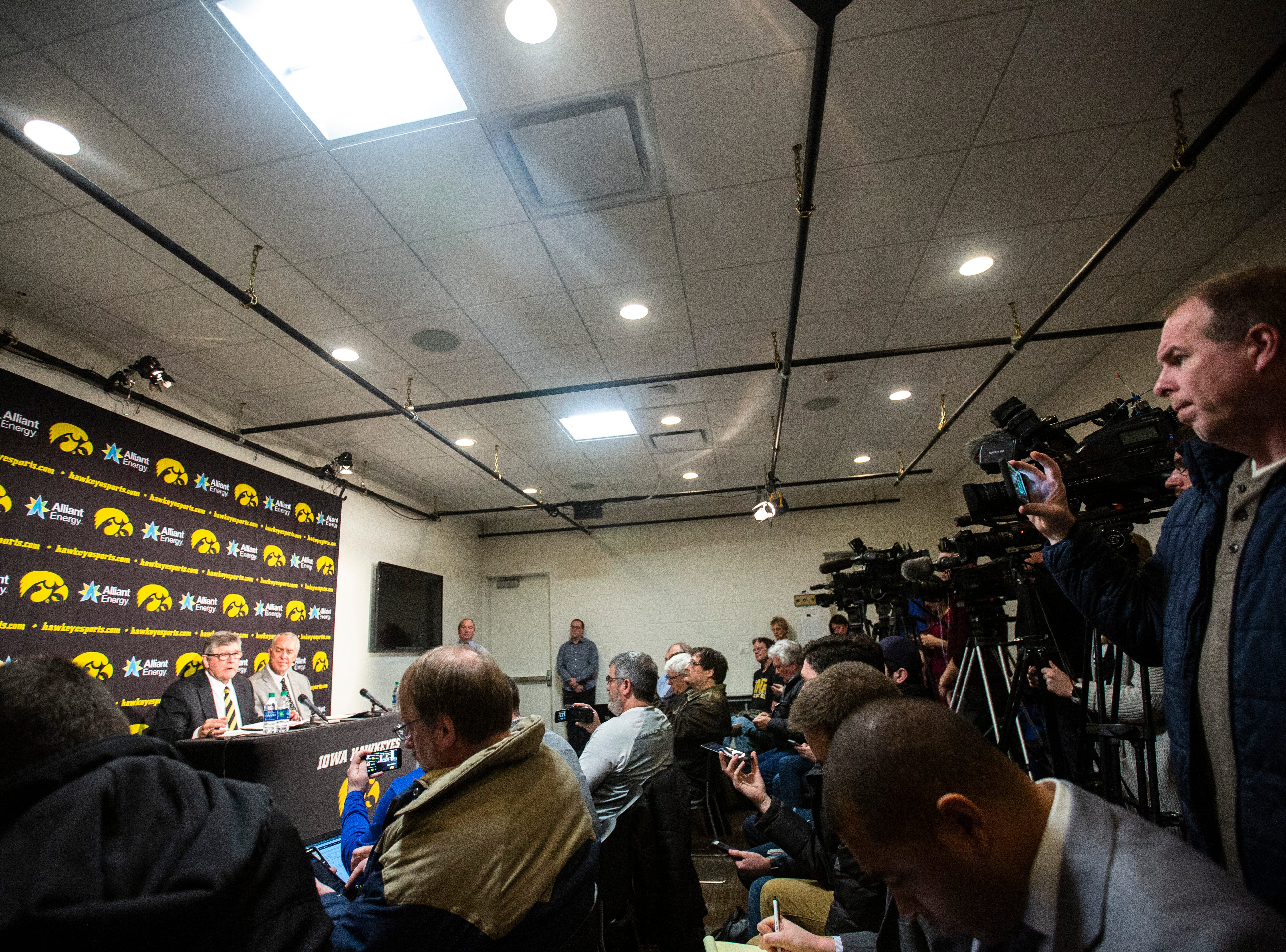 Iowa play-by-play commentator Gary Dolphin, left, speaks while Iowa athletic director Gary Barta listens during a press conference on Wednesday, Feb. 27, 2019, at Carver-Hawkeye Arena in Iowa City, Iowa.