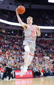 Feb 26, 2019; Columbus, OH, USA; Ohio State Buckeyes forward Justin Ahrens (10) shoots a layup during the first half against the Iowa Hawkeyes at Value City Arena.