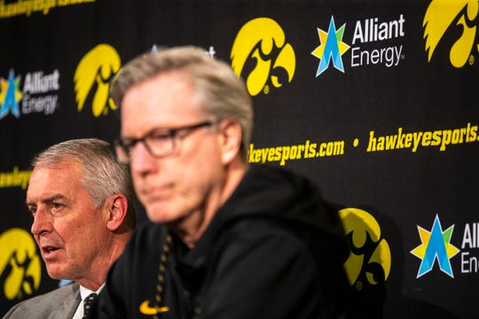 Iowa athletic director Gary Barta, left, speaks during a press conference with Iowa men's basketball head coach Fran McCaffery on Wednesday, Feb. 27, 2019, at Carver-Hawkeye Arena in Iowa City, Iowa.