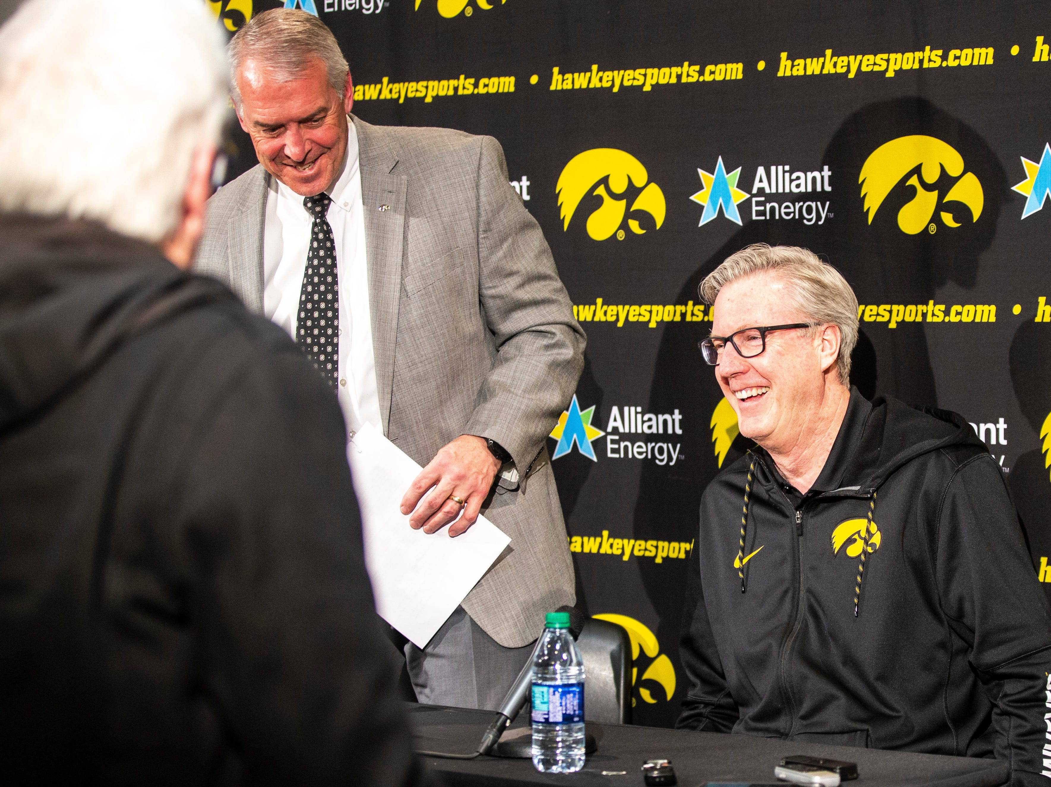Iowa athletic director Gary Barta, left, and Fran McCaffery leave a press conference on Wednesday, Feb. 27, 2019, at Carver-Hawkeye Arena in Iowa City, Iowa.