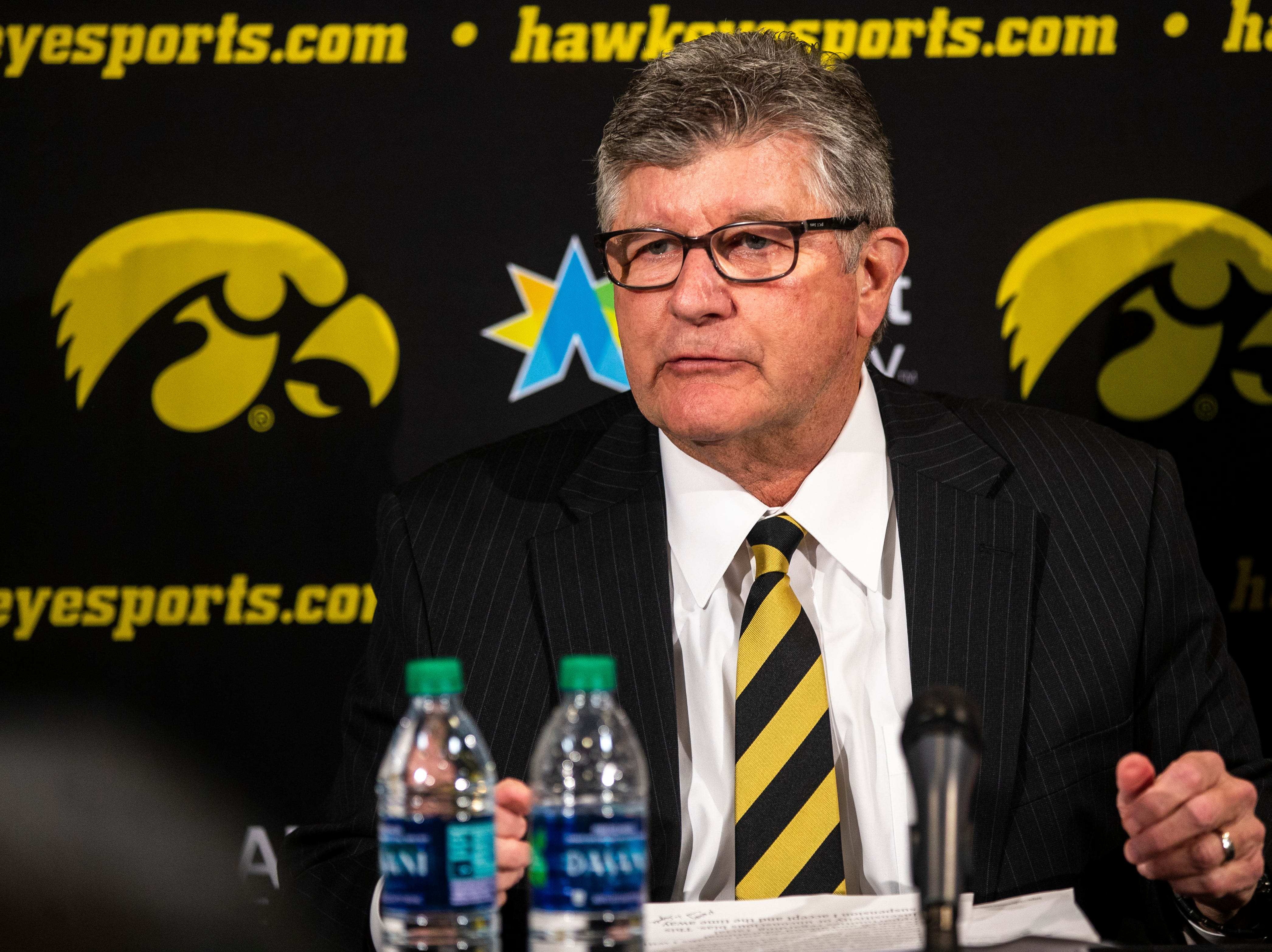 Iowa play-by-play commentator Gary Dolphin, left, and Iowa athletic director Gary Barta during a press conference on Wednesday, Feb. 27, 2019, at Carver-Hawkeye Arena in Iowa City, Iowa.
