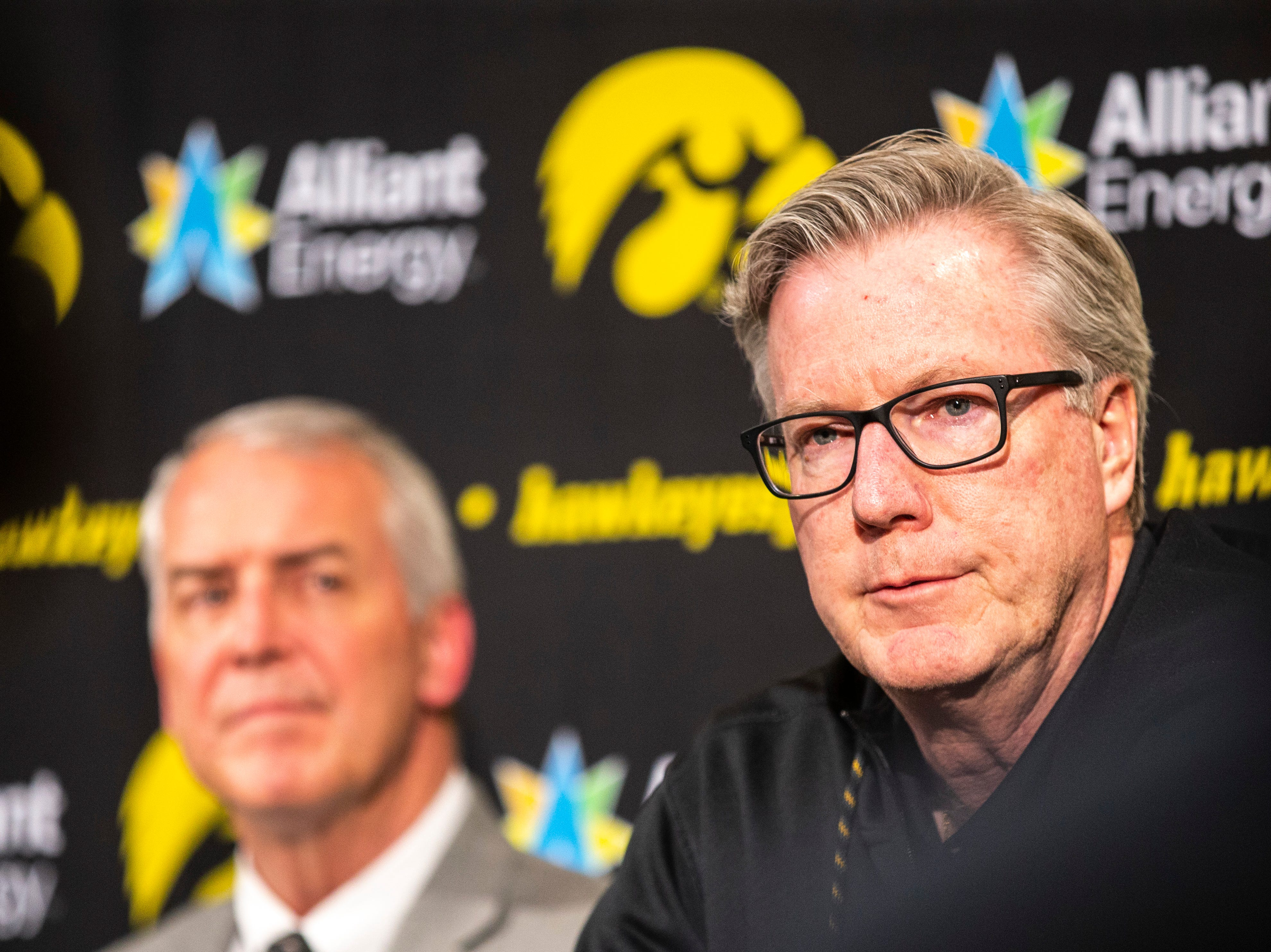 Iowa men's basketball head coach Fran McCaffery, right, speaks during a press conference with Iowa athletic director Gary Barta on Wednesday, Feb. 27, 2019, at Carver-Hawkeye Arena in Iowa City, Iowa.