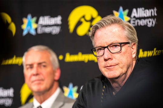 Fran McCaffery, right, spent 20 minutes facing questions from the Iowa media on Thursday -- a day after his profanity-laced tirade toward a Big Ten official that accused him of cheating. Athletics director Gary Barta, left, handed McCaffery a two-game suspension.
