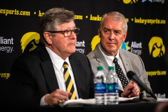 Iowa broadcaster Gary Dolphin, left, speaks while athletic director Gary Barta listens during a press conference on Wednesday in Iowa City.