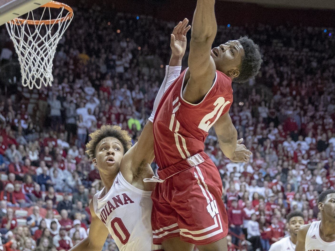 Indiana Hoosiers guard Romeo Langford looks for a rebound with Wisconsin Badgers guard Khalil Iverson (right), during first half action, Assembly Hall, Bloomington, Tuesday, Feb. 26, 2019.
