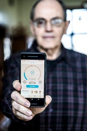 Dale Brubake of Avon uses an app on his smartphone to keep slim.