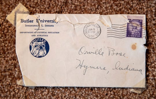 A letter of acceptance to Butler University, featuring an incomplete but valid address, is displayed at the home of Orville Bose on Feb. 22, 2019 in his Carmel home. Bose is a former Butler University great who was coached by Tony Hinkle, namesake of the university's Hinkle Fieldhouse.