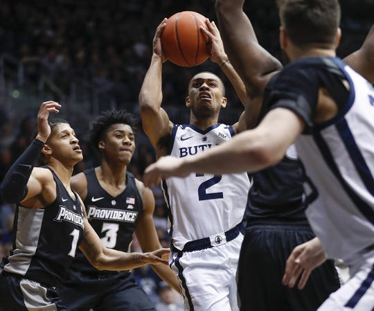 Butler Bulldogs guard Aaron Thompson (2) drives to the basket by Providence Friars guard Makai Ashton-Langford (1) in the first half of their game at Hinkle Fieldhouse on Tuesday, Feb 26, 2019.