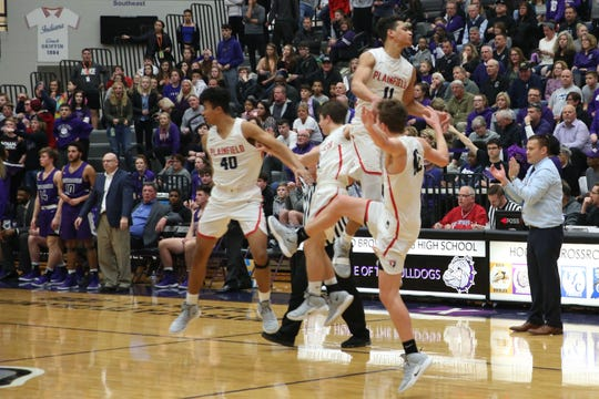 The Plainfield players celebrate their victory at the end of Brownsburg vs. Plainfield high school boys varsity basketball game held at Brownsburg High School, February 26, 2019.