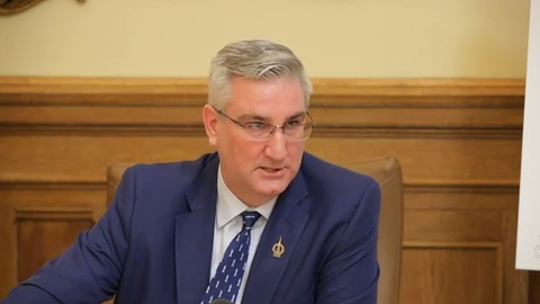 Gov . Eric Holcomb defended the state's work requirements for Medicaid recipients.