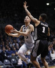Butler Bulldogs guard Paul Jorgensen (5) drives around Providence Friars guard Makai Ashton-Langford (1) in the first half of their game at Hinkle Fieldhouse on Tuesday, Feb 26, 2019.