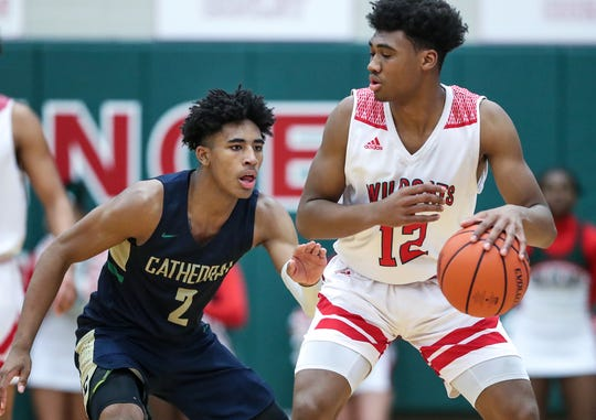 Cathedral Fighting Irish guard Armaan Franklin (2) guards Lawrence North Wildcats guard Tony Perkins (12) during the second half of sectional quarterfinals at Lawrence North High School in Indianapolis on Tuesday, Feb. 26, 2019. Lawrence North won, 65-59.