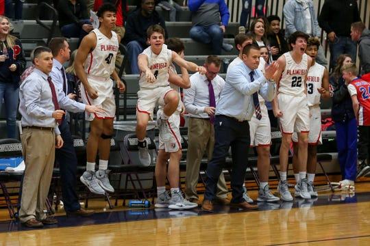 The Plainfield bench shows their excitement as their team pulls ahead in the final minute of the game of Brownsburg vs. Plainfield high school boys varsity basketball game held at Brownsburg High School, February 26, 2019.