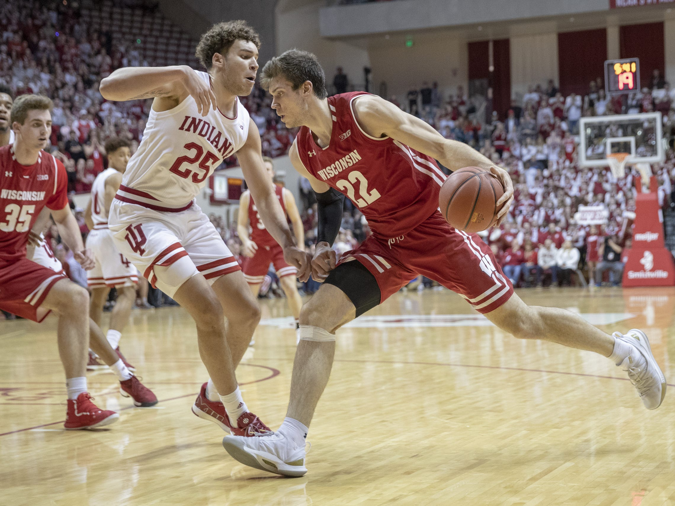 Indiana Hoosiers forward Race Thompson (left), defends Wisconsin Badgers forward Ethan Happ, first half action, Assembly Hall, Bloomington, Tuesday, Feb. 26, 2019.